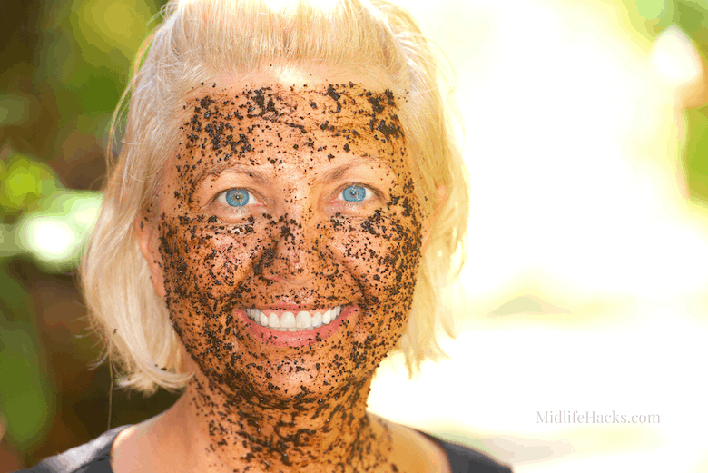 Woman with a coffee ground face mask