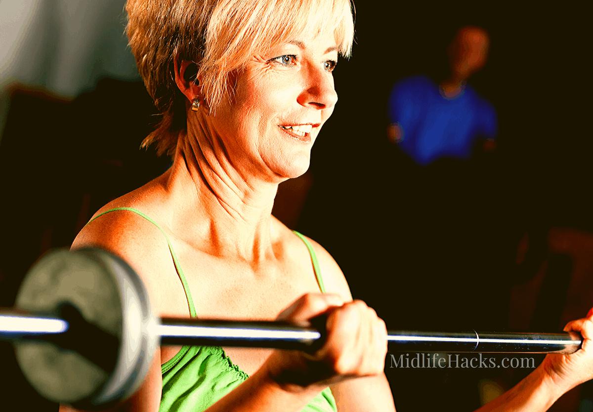 mature woman using barbells