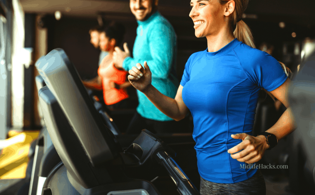 Couple running on treadmill wearing compression tops