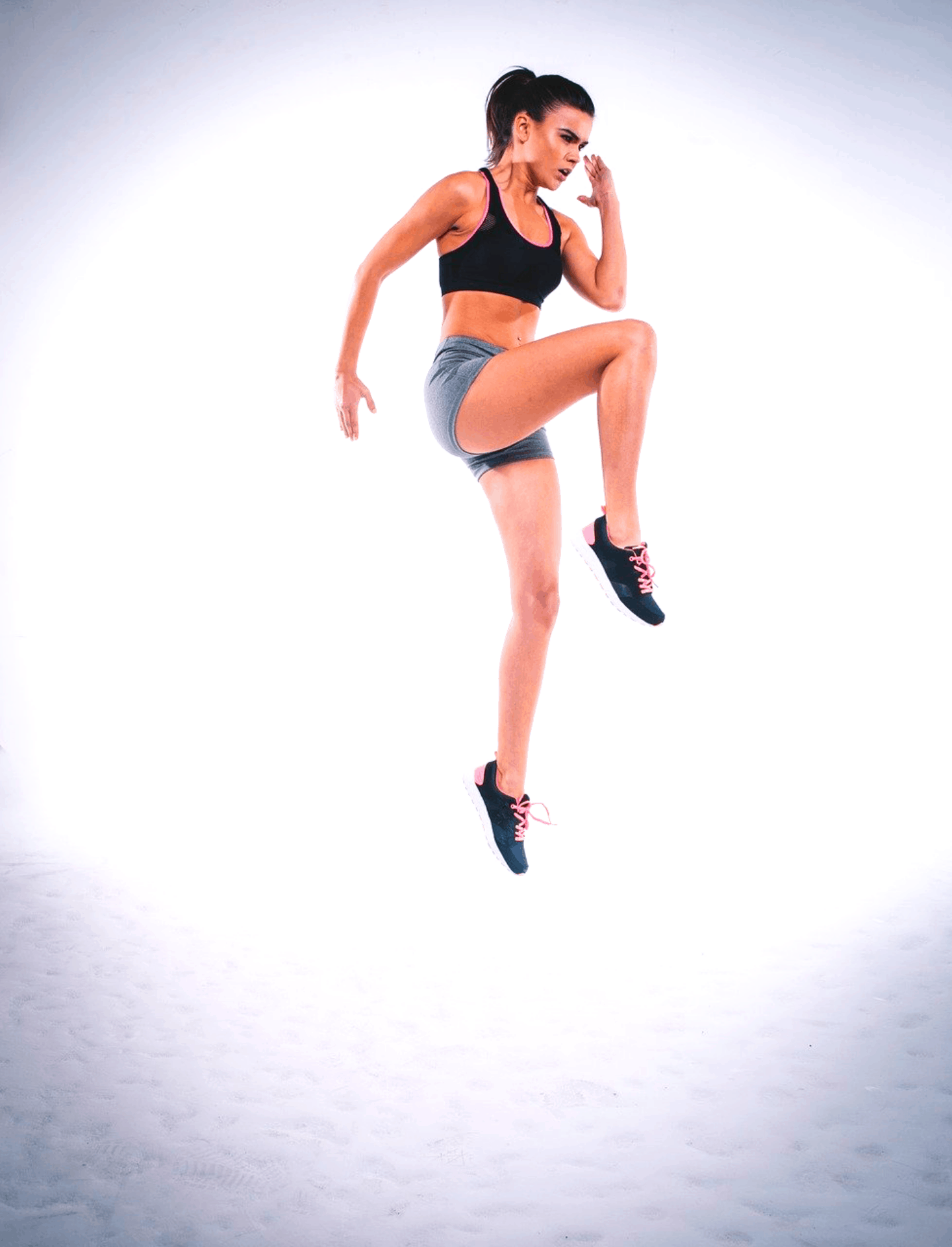 Girl jumping with a high impact sports bra