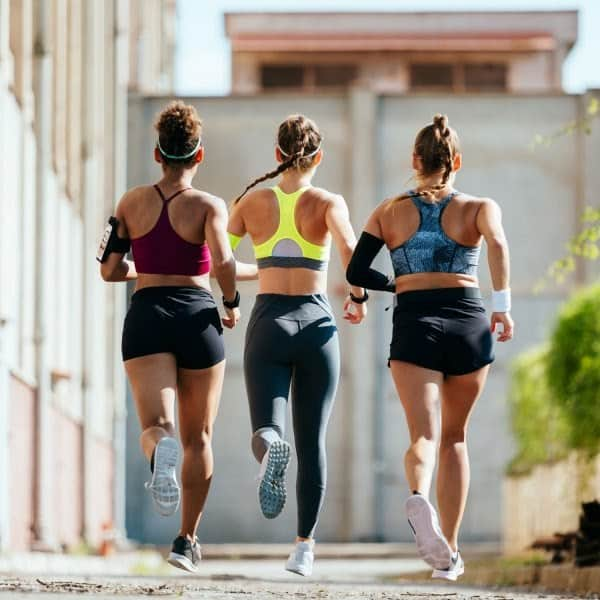 3 girls running in compression sports bras