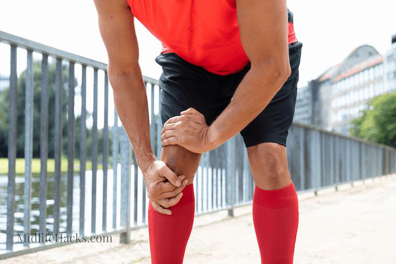 man massaging knee after run