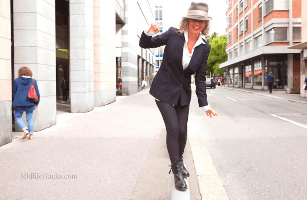 woman balancing in the street