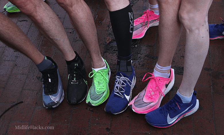 Lower legs of runners showing off their shoes lets explore trainers vs running shoes vs walking shoes
