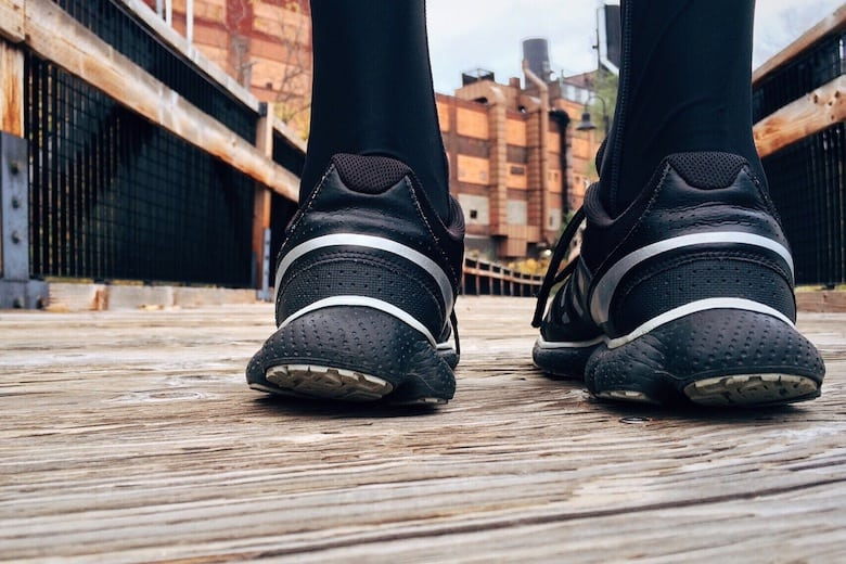 The heels of sports shoes with a background of industrial style hoka vs brooks