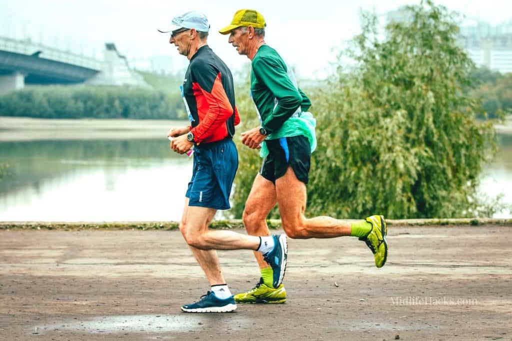 2 older male runners running with hats and the best running shoes