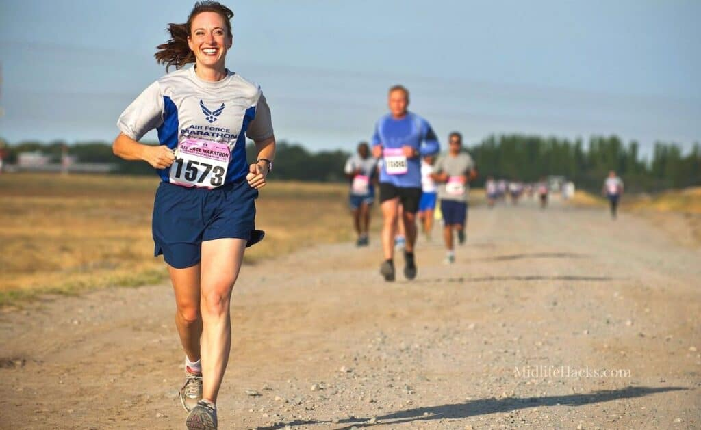 Smiling running woman in one of our fave and best moisture wicking shirts