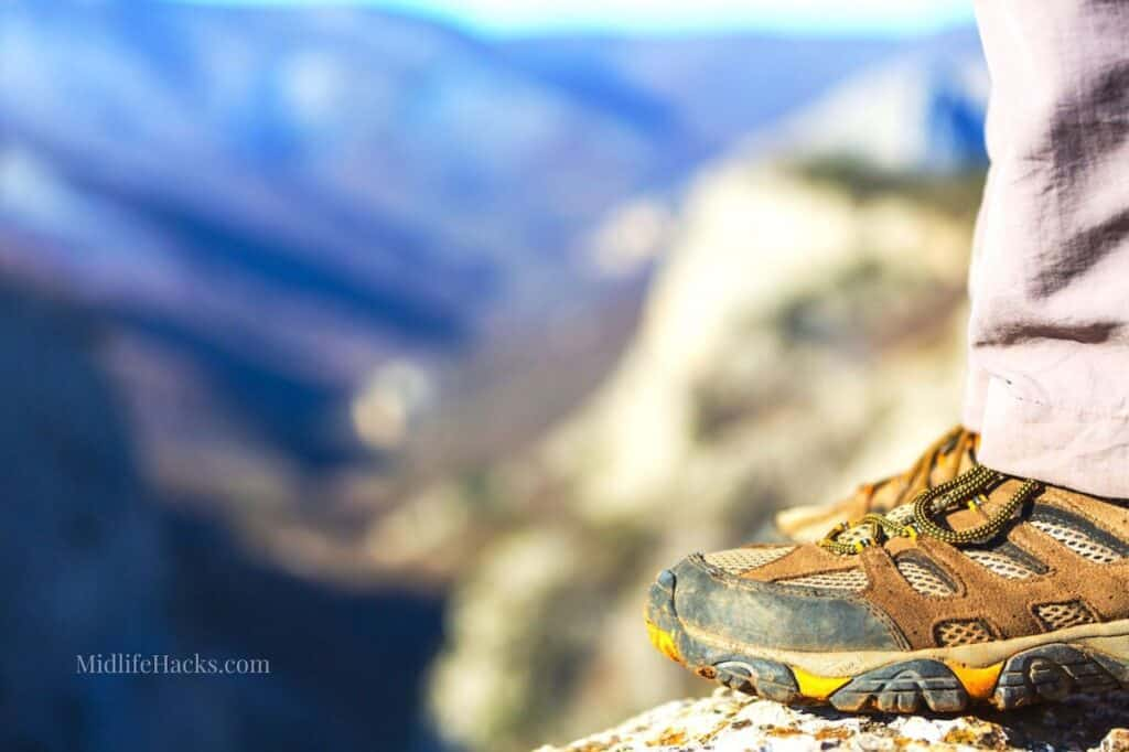 View across mountains with mans hiking best hiking shoes for flat feet