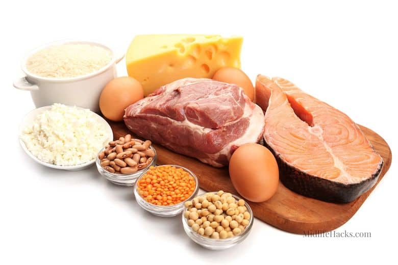 Protein foods, nuts, salmon, cheese, egg on board with white background