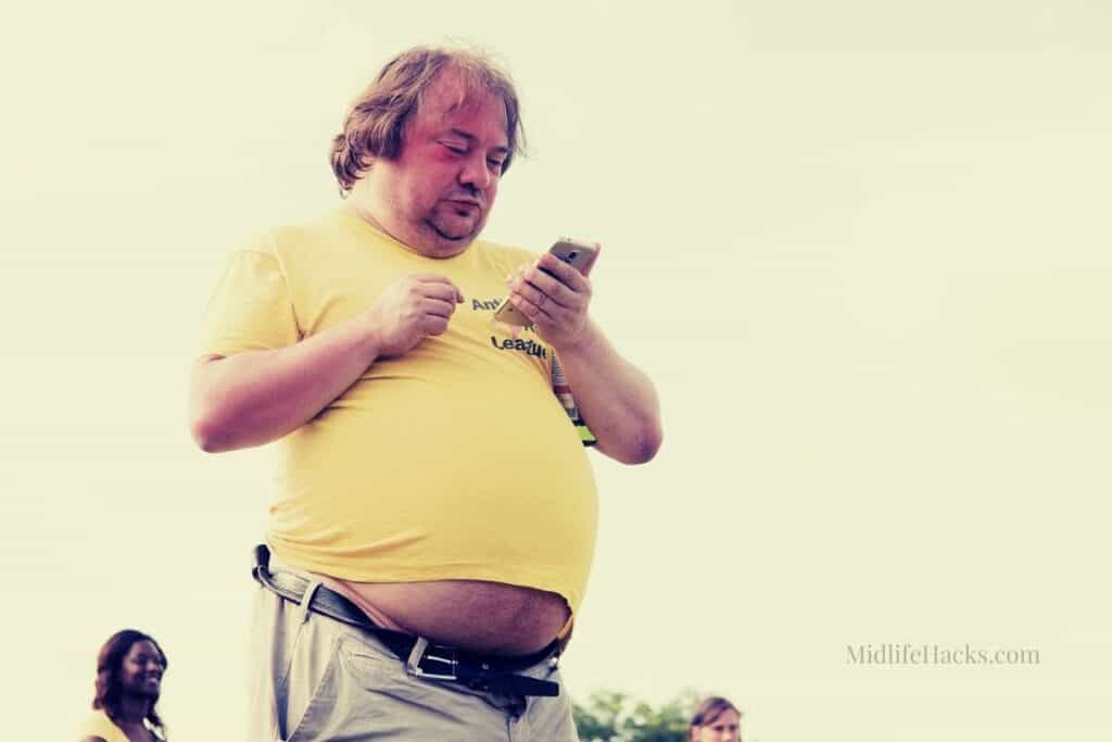 Man on the phone with a beer belly