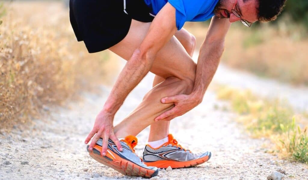 Runner stopped and holding his heel