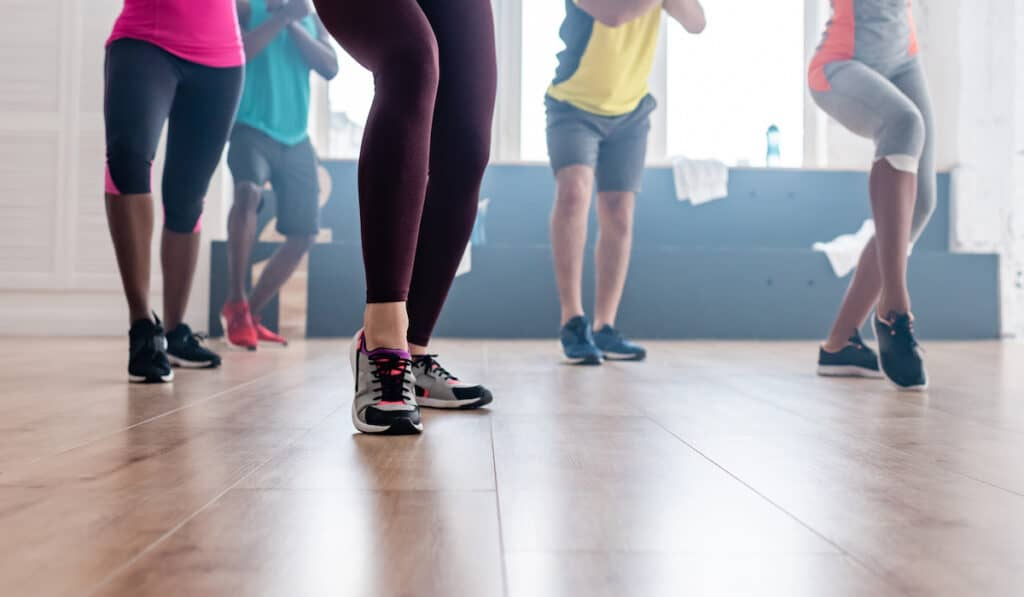5 people wearing the best shoes for zumba and doing it