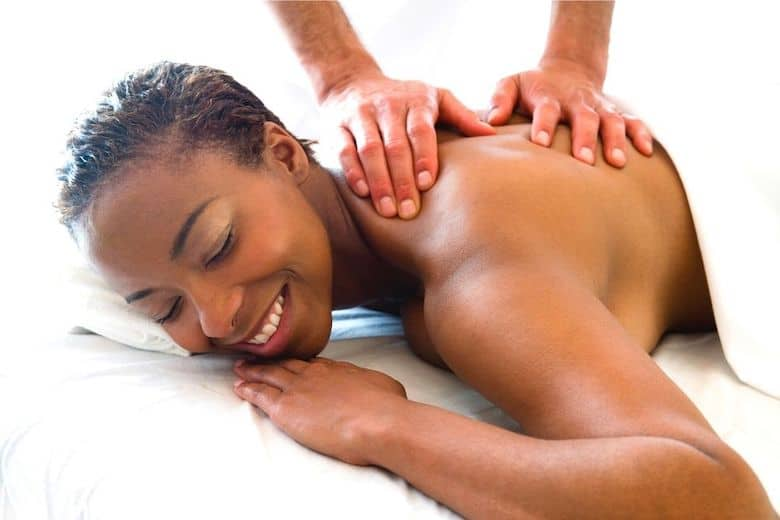 black woman preferring her best back massager for knots to be done by professional hands