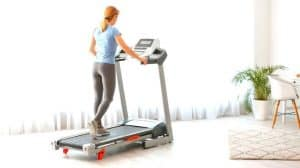 woman walking on best compact treadmill at home