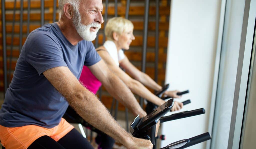 middle age couple exercising on the best exercise bike for seniors