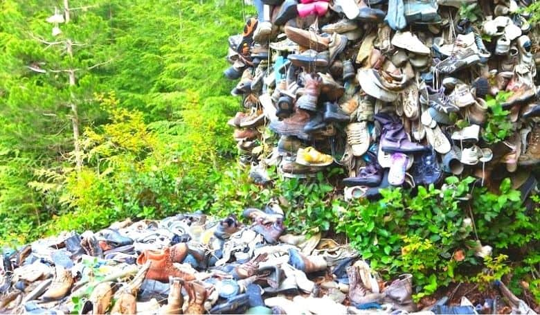A tip in the woods, not the way to recycle running shoes
