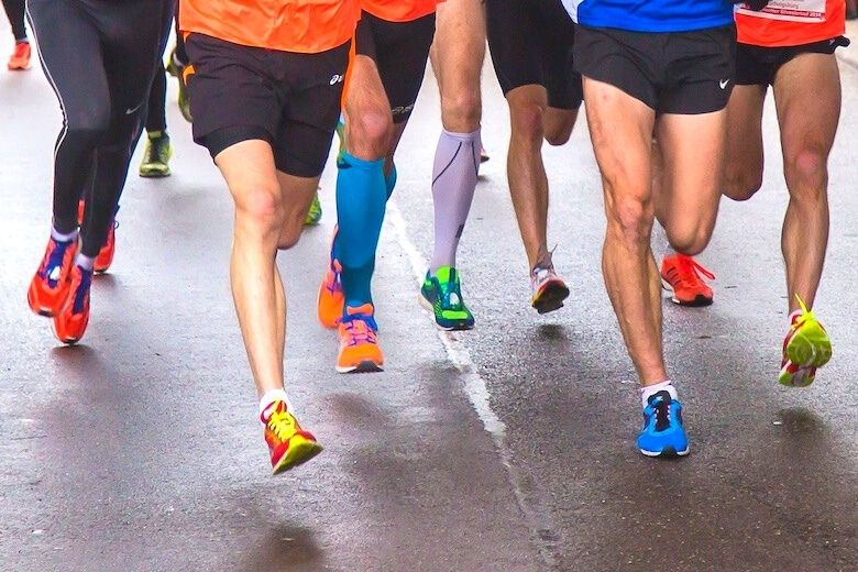 lower halves of 6 running men showing their different taste for shoes and shorts