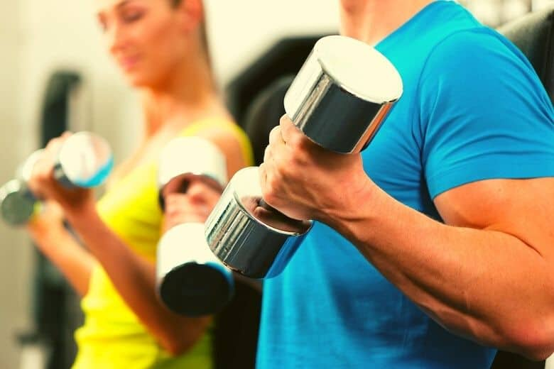 a couple doing a beginners dumbbell workout